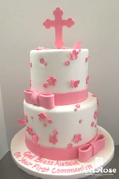 Pink cross sign cake by La Rose in Milton, ON