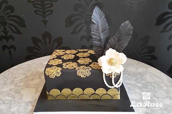 Decorative black cake by La Rose in Milton, ON