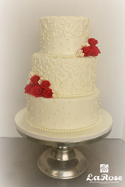 Scroll And Dots On White Fondant Cake