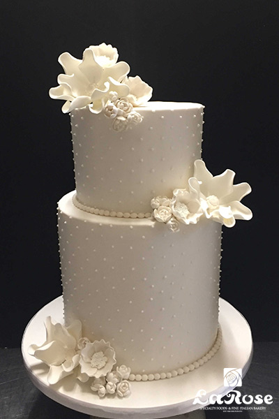 Simple White With Gumpaste Flowers Cake
