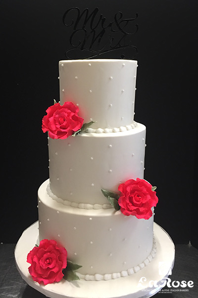 Simple White With Hot Pink Gumpaste Roses by La Rose in Milton, ON