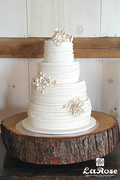 Strip Ruffle With Pearl Flowers Cake by La Rose in Milton, ON